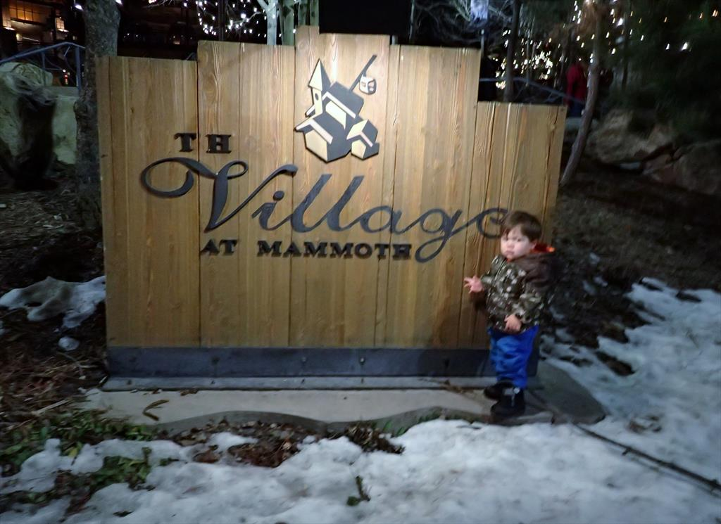 0004-Lucas (1.5 yrs) at The Village at Mammoth sign.JPG